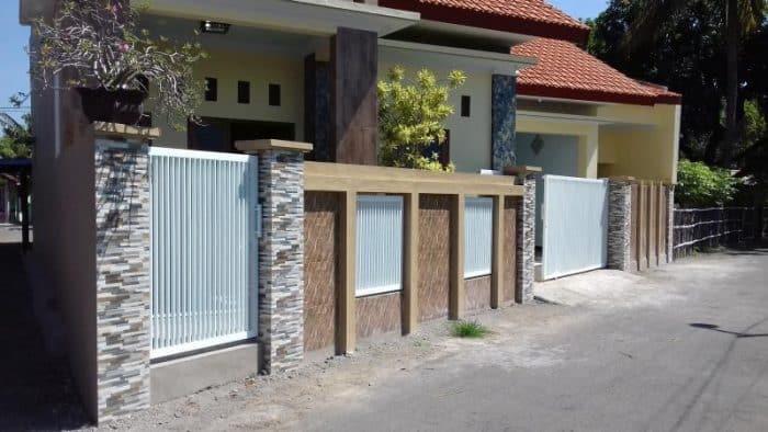 Rumah Minimalis Pagar Tembok dan Besi