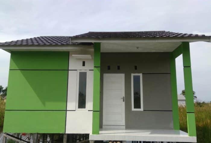 Desain rumah hijau abu-abu